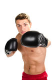 Muscular man boxing Royalty Free Stock Photos