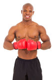 Muscular man boxing gloves Stock Images