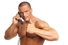 Muscular man call with phone Royalty Free Stock Photography