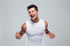 Muscular man celebrating his success Stock Photos