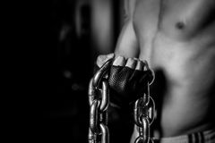 Muscular Man with chains on Black background Royalty Free Stock Image