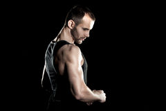 Muscular man,  clasps hands in  fist, black Stock Photo