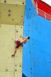 Muscular man climbing Stock Image