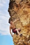 Muscular man climbing Royalty Free Stock Image