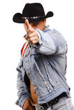 A muscular man in a cowboy hat Royalty Free Stock Image