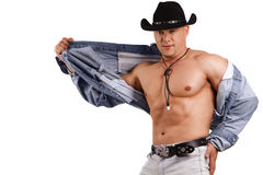 A muscular man in a cowboy hat Stock Photos