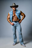 Muscular man in a cowboy hat Royalty Free Stock Photos
