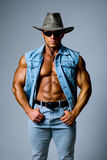 Muscular man in a cowboy hat Royalty Free Stock Photo