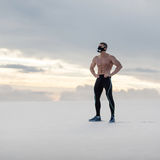 Muscular man in crossfit mask showing muscle outdoors. Sporty fitness male naked torso abs Stock Images