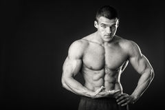 Muscular man on a dark background Royalty Free Stock Image