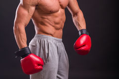 Muscular man on a dark background Royalty Free Stock Images