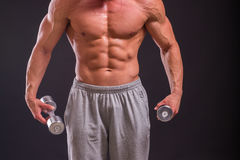 Muscular man on a dark background Royalty Free Stock Photo