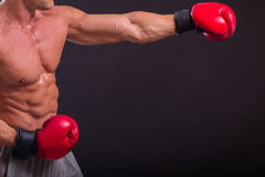 Muscular man on a dark background Stock Images