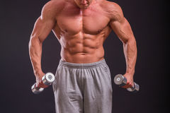 Muscular man on a dark background Royalty Free Stock Photography