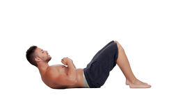 Muscular man doing abdominals Stock Image