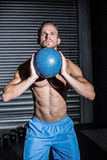 Muscular man doing ball exercise Royalty Free Stock Photography