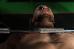 Muscular Man Doing Bench Press Exercise For Chest Stock Photography