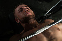 Muscular Man Doing Bench Press Exercise For Chest Stock Images