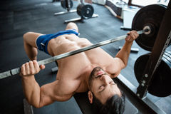 Muscular man doing bench press Stock Image