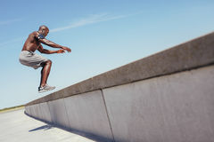 Muscular man doing box jumps outdoors. Royalty Free Stock Photo