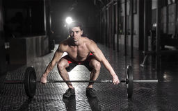 Muscular man doing the crossfit exercise in the gym.Crossfit wit stock image