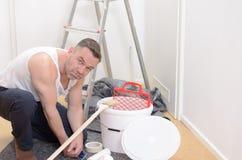 Muscular man doing DIY renovations Stock Image