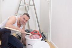 Muscular man doing DIY renovations Stock Images