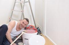 Muscular man doing DIY renovations Stock Photo