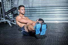 Muscular man doing exercise with medicine ball Royalty Free Stock Image