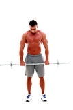 Muscular man doing exercises with barbell Royalty Free Stock Photography