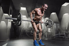 Muscular Man Doing Heavy Deadlift Exercise Stock Photo