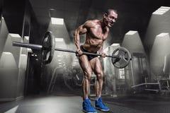 Muscular Man Doing Heavy Deadlift Exercise Stock Photo