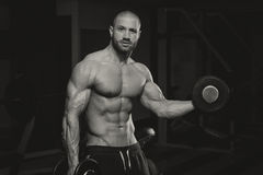Muscular Man Doing Heavy Weight Exercise For Biceps Royalty Free Stock Photos