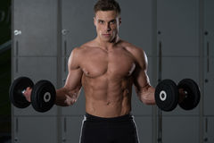 Muscular Man Doing Heavy Weight Exercise For Biceps Royalty Free Stock Photography