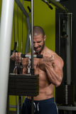 Muscular Man Doing Heavy Weight Exercise For Biceps Stock Images