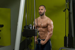 Muscular Man Doing Heavy Weight Exercise For Triceps Royalty Free Stock Images