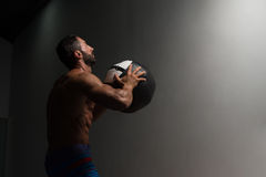 Muscular Man Doing Medecine Ball Exercises stock image