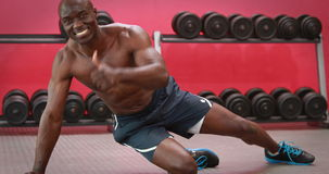 Muscular man doing press up claps at crossfit stock footage