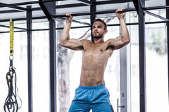 Muscular man doing pull up exercises Stock Photo