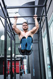 Muscular man doing pull ups Royalty Free Stock Images