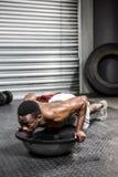 Muscular man doing push up on bosu ball Stock Photography