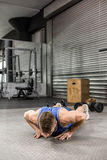 Muscular man doing push up. At the crossfit gym Stock Photography