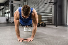 Muscular man doing push up. At the crossfit gym Stock Photo