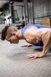 Muscular man doing push up. At the crossfit gym Stock Images