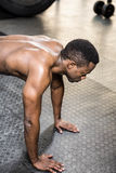 Muscular man doing push up. At the crossfit gym Royalty Free Stock Image