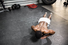 Muscular man doing push up. At the crossfit gym Royalty Free Stock Photos