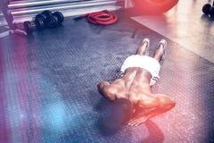 Muscular man doing push up. At crossfit gym Stock Photos