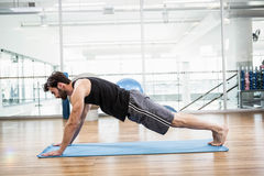 Muscular man doing push up on mat Royalty Free Stock Photography