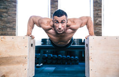 Muscular man doing push ups on fit box Royalty Free Stock Photo