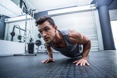 A muscular man doing a pushups Stock Photos